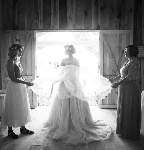 Bride, sister and mom share in the special moments of the finishing touches.