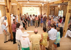 Guests making a circle while square dancing at White Pine Grove.