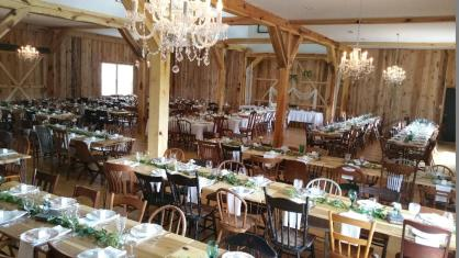 Wooden tables and chairs at White Pine Grove