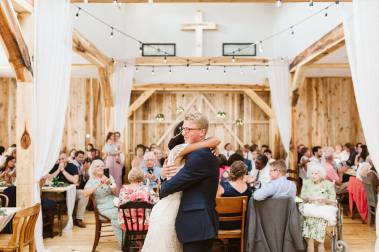 A happy and relaxed bride and groom enjoy their first dance!